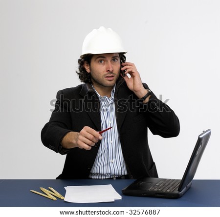 Young architect at work with laptop isolated - stock photo