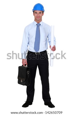 Young architect holding briefcase and plans - stock photo