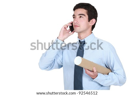 Young architect making a telephone call - stock photo