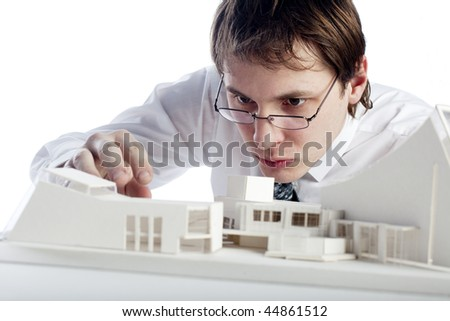 young architect making architectural model - stock photo
