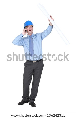 Young architect shouting down mobile telephone