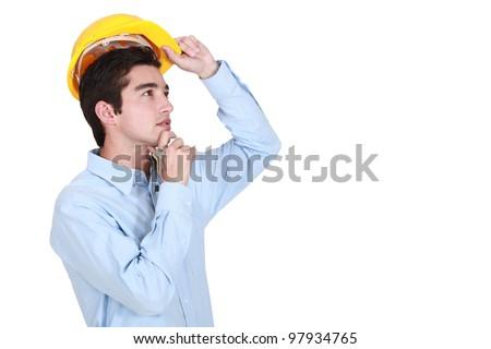Young architect thinking. - stock photo