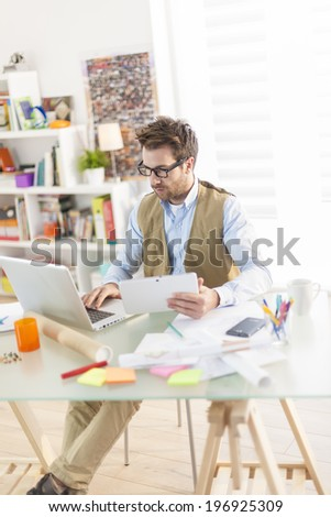 young architect using digital tablet at office - stock photo