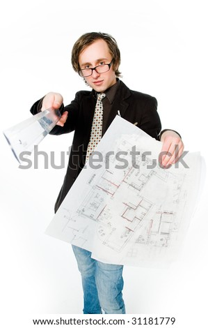 Young architect with sketch and ruler, studio shot - stock photo