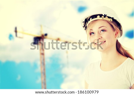 Young architect woman in white helmet - stock photo