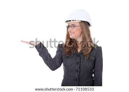 Young architect woman wearing a protective helmet, presenting something on hand. Isolated on white background - stock photo