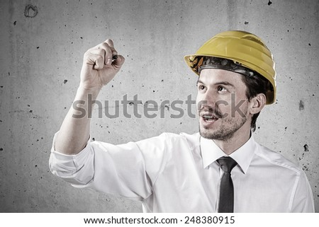 Young architect writing the text you like - stock photo