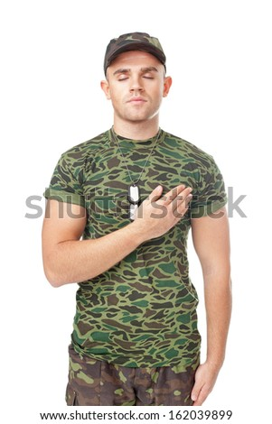 Young army soldier swear solemnly with hand on heart isolated on white background - stock photo