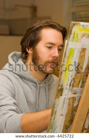 young artist drawing at studio - stock photo