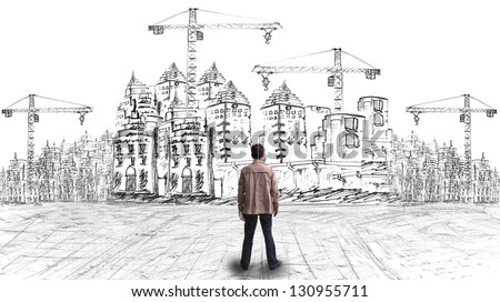 young artist looking to his project of modern building design for creative new town - stock photo