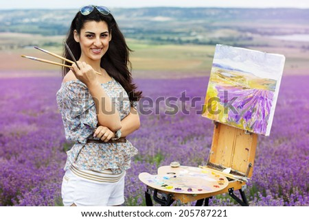 Young artist painting an floral landscape - stock photo