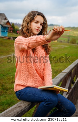 Young artist with pencil is ready to sketch - stock photo