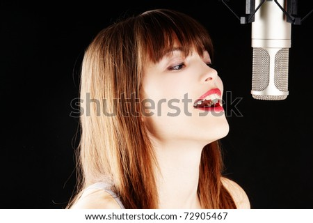 young artist woman recording in a studio - stock photo