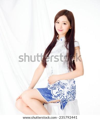 Young asia Oriental  woman wearing chinese qipao dress - stock photo