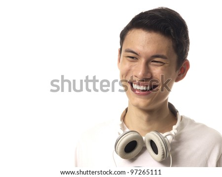 Young Asiam Man with Headphones Over white background