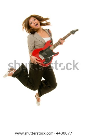 Young Asian adult woman jumping up in the air while playing guitar.  Shot on white. Substantial motion blur from moving, jumping subject. - stock photo