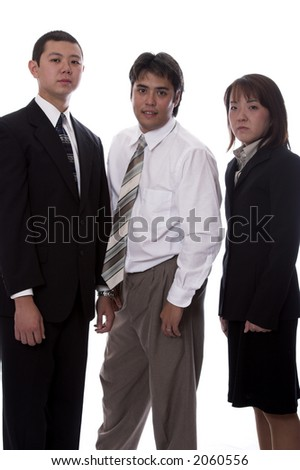 Young asian and american co-workers look into the camera - stock photo