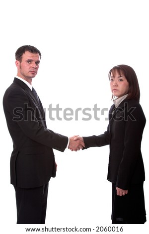 Young asian and american co-workers shaking hands - stock photo