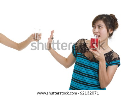 young asian beauty refusing an apple prefering a hamburger, isolated on white background - stock photo