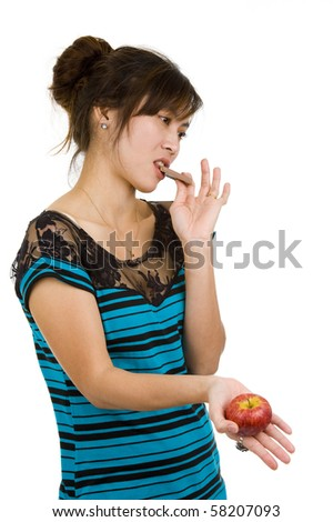 young asian beauty with chocolate and apple, isolated on white background - stock photo