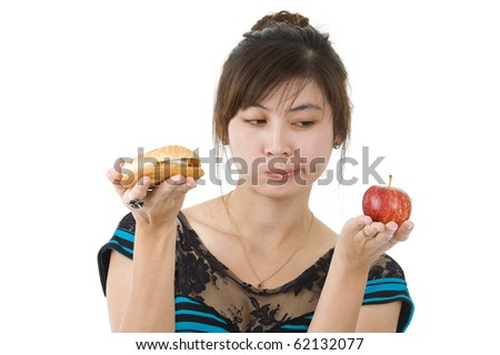 young asian beauty with hamburger and apple, isolated on white background - stock photo