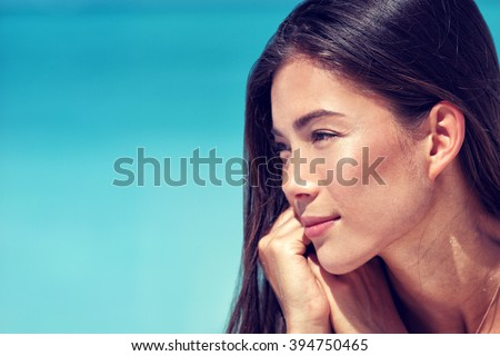 Young Asian beauty woman face closeup portrait. Mixed race Chinese Caucasian girl profile with healthy glowing skin and natural makeup on cheeks, eyelids, eyebrows, lips. Skincare concept. - stock photo