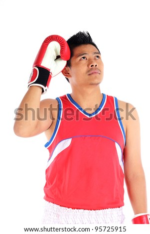 young asian boxer in thinking for future situation - stock photo