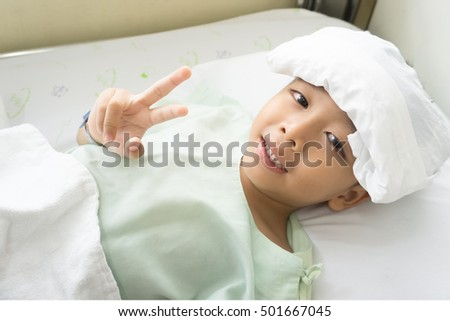 Young asian boy child in a hospital bed