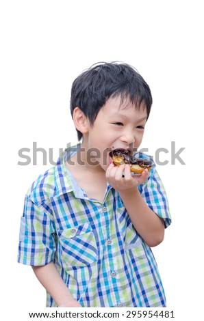 Young Asian boy eating donut over white - stock photo