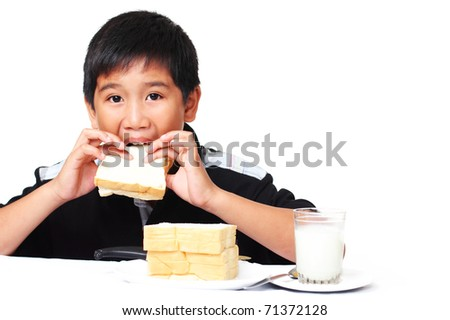 young asian boy eating sandwich - stock photo