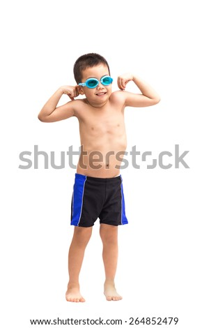 Young asian boy in swimsuit and blue swim goggles - stock photo