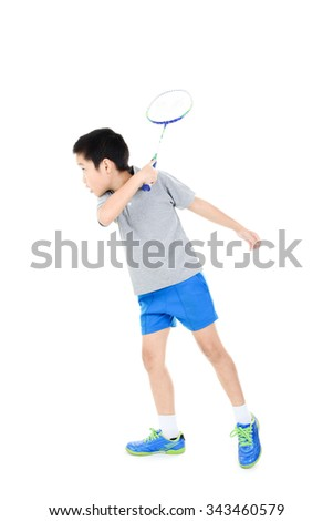 Young asian boy play badminton on white background