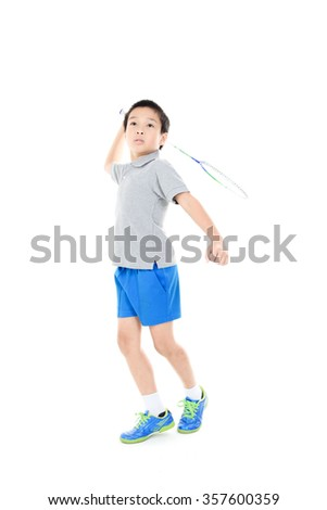 Young asian boy play badminton on white background - stock photo