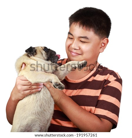 Young asian boy playing with his dog, Isolated over white