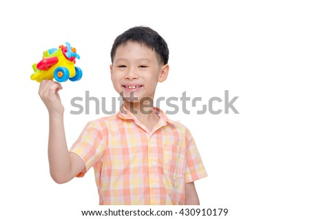 Young asian boy playing with plastic plane over white - stock photo