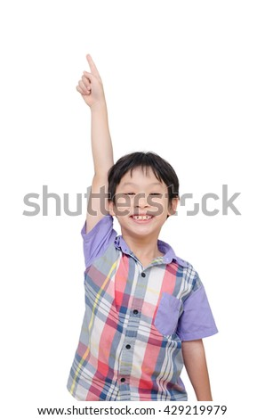 Young asian boy pointing up over white background - stock photo