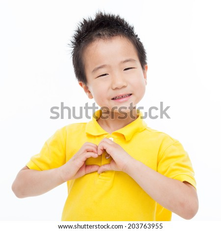 Young Asian boy showing heart shape isolated on white.  - stock photo