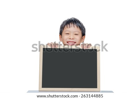 Young Asian boy smile with chalkboard over white background - stock photo