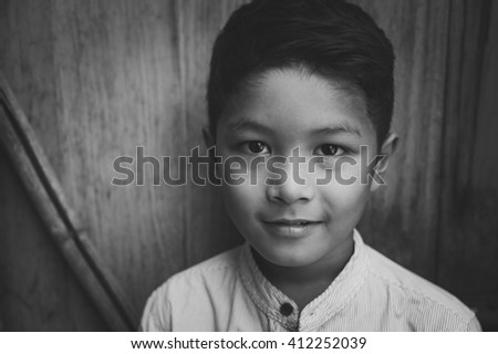 Young Asian boy smiling