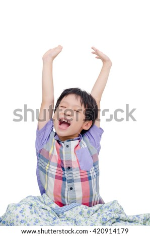 Young asian boy stretching over white background