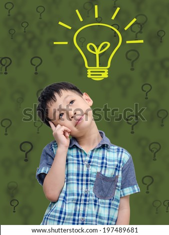 Young Asian boy thinking isolated on green background with bulb  - stock photo