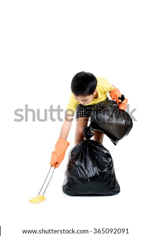 Young Asian boy use metal pinch to collect garbage in plastic bag for eliminate on the white background