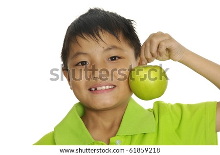 young asian boy with green apple - stock photo