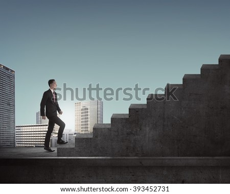 Young asian business man getting steps up to the stairs