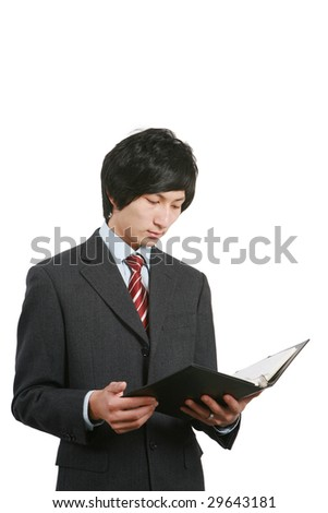 young asian business man holding book and pen