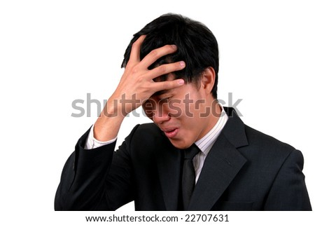 Young Asian Business man stressed. - stock photo