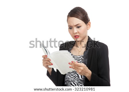 Young Asian business woman confused with a book  isolated on white background