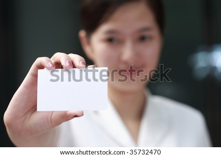 young asian Business woman handing a blank business card