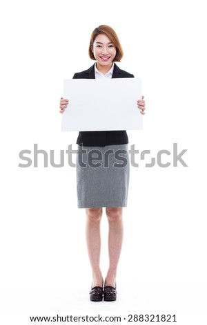 Young Asian business woman holding a blank banner isolated on white background. - stock photo