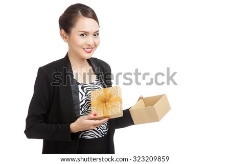Young Asian business woman open a golden gift box  isolated on white background - stock photo